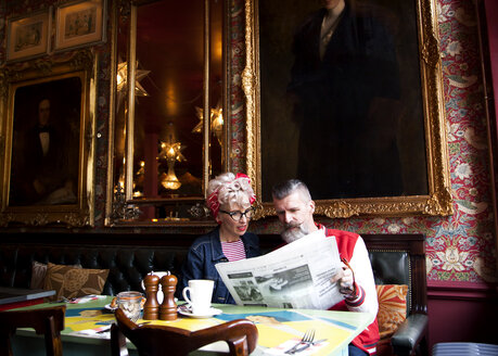 Quirky couple relaxing in bar and restaurant, Bournemouth, England - CUF12375