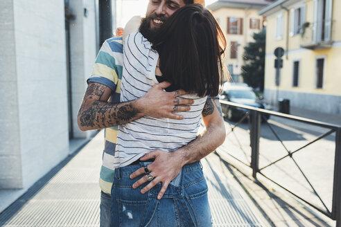 Romantic couple hugging on sidewalk - CUF12459