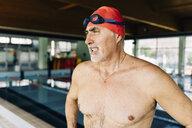 Senior man beside swimming pool - CUF12786