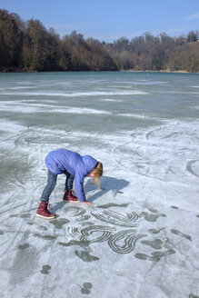 Girl playing on icy surface - HAMF00320