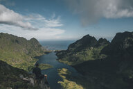 Norway , Lofoten, Traveller sitting on rock, looking over Agvatnet lake - GUSF00758