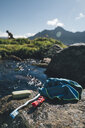 Norway, Lofoten, Moskenesoy, Washbag and soap at a fjord - GUSF00782