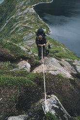 Norway, Lofoten, Moskenesoy,  Group of young men hiking at Vinstad - GUSF00836