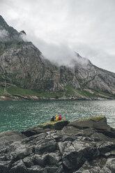 Norway, Lofoten, Moskenesoy, Young men fishing at Horseid Beach - GUSF00866