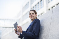 Portrait of smiling businesswoman with tablet - DIGF04324