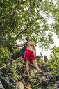 Laos, Vang Vieng, young man hiking in the jungle - AFVF00521