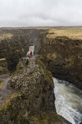 Iceland, North of Iceland, hiker looking to canyon - AFVF00527