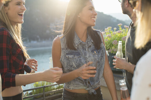 Four adult friends partying on waterfront roof terrace, Budapest, Hungary - ISF02206