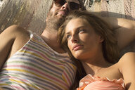 Couple relaxing in hammock - ISF02275