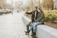 Young couple taking selfie in city, Boston, Massachusetts, USA - ISF02454