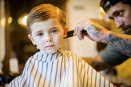 Barber combing boy's hair - ISF03005
