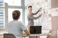Male digital designer preparing mood board in office - ISF03392