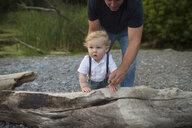 Man with toddler son toddling on beach, Lake Ontario, Canada - ISF03638