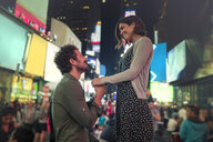 Man on one knee proposing in Times Square, New York, United States, North America - ISF03740