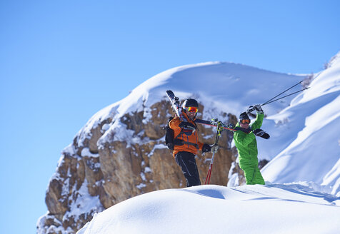 Two male skiers trudging up snow covered ridge, Aspen, Colorado, USA - ISF04022