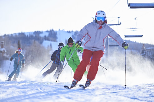 Male and female skiers skiing on snow covered ski slope, Aspen, Colorado, USA - ISF04037