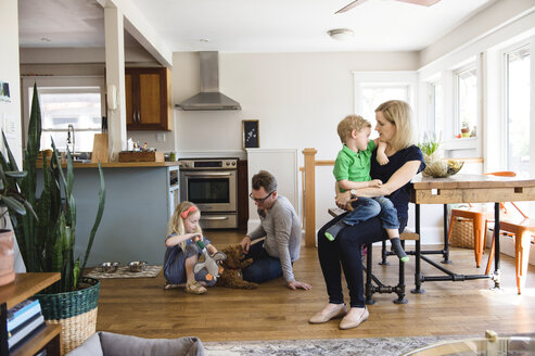 Parents in kitchen together with son and daughter - ISF04349
