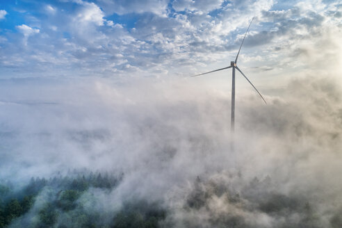 Germany, Baden-Wuerttemberg, Schurwald, Aerial view of wind wheel and morning fog - STSF01562