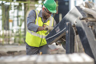 Construction worker using heavy machinery - ISF04972