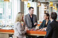 Businessman and businesswoman in discussion in cafe - ISF05095