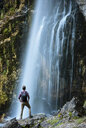 Hiker looking at waterfall, Accursed mountains, Theth, Shkoder, Albania, Europe - ISF05521