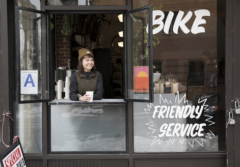 Female employee at service window, Nike and Coffee shop, New York, USA - ISF05578