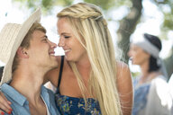 Romantic young couple at beach party - ISF05683