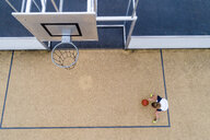 Young woman playing basketball, top view - STSF01583