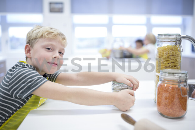 Portrait of smiling schoolboy in cooking class - WESTF24075