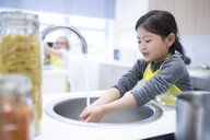 Schoolgirl washing her hands in cooking class - WESTF24084