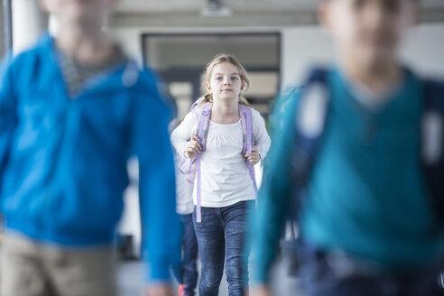 Schoolgirl with classmates leaving school - WESTF24099