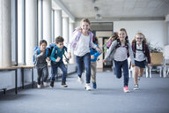 Excited pupils rushing down school corridor - WESTF24183