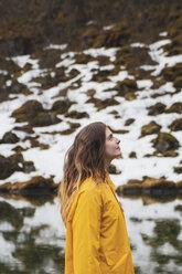 Iceland, smiling woman in Icelandic landscape - KKAF01078