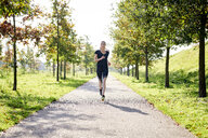 Young woman running in a park - MMIF00088