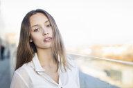 Portrait of beautiful mid adult woman on city walkway - CUF13176