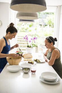 Two friends enjoying salad lunch - ISF06273