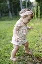 Barefoot female toddler in garden - ISF06383