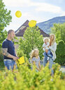 Austria, Wattens, happy family playing together in a park - CVF00624