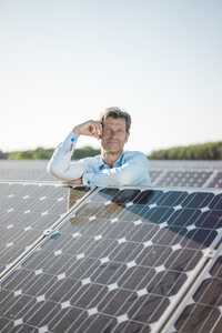 Mature man standing in solar plant - MOEF01189