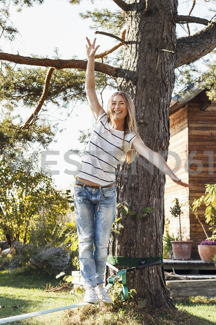 Woman balancing along rope on tree - CUF13793 - Emely/Westend61