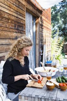 Woman preparing lunch al fresco - CUF13829