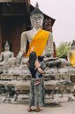 Thailand, Ayutthaya, back view of mother and little daughter visiting Wat Yai Chaya Mongkhon - GEMF02024