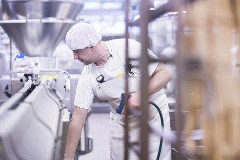 Factory worker using water spray gun - CUF14108