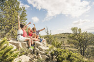 Young man and friends taking selfie sitting on rocks, Bridger, Montana, USA - CUF14528