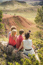 Young man and friends taking smartphone selfie on rocks, Bridger, Montana, USA - CUF14549
