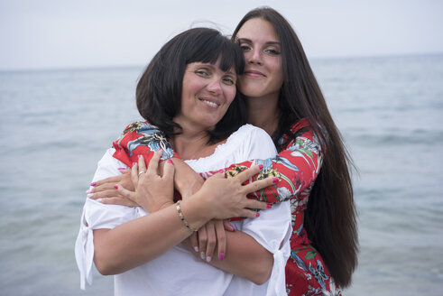 Greece, portrait of happy mother and daughter in front of the sea - BEF00100