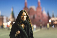 Russia, Moscow, young woman visiting Red Square at night - WPEF00346