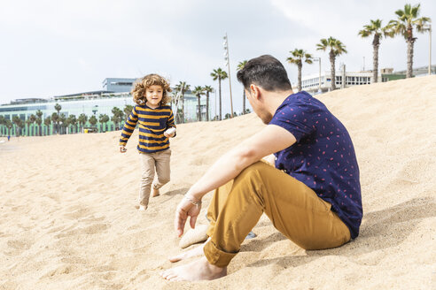 Spain, Barcelona, father and son on the beach - WPEF00355