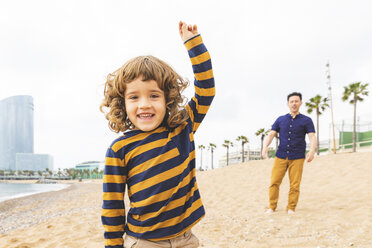 Spain, Barcelona, happy father and son on the beach - WPEF00373