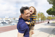 Spain, Barcelona, father and son playing together and having fun - WPEF00388